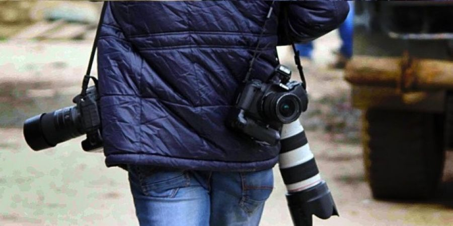 Photojournalist beaten after taking photographs of lover couple in rain