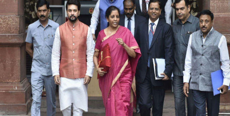 Finance Minister Nirmala Sitharaman says corporate tax for companies to be cut gradually
