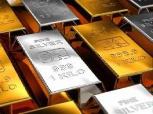 Gold futures rise, silver falls