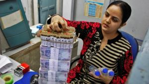 Rupee jumps 15 paise against dollar to 64.39