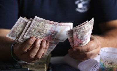 Rupee slides by 10 paise in early trade