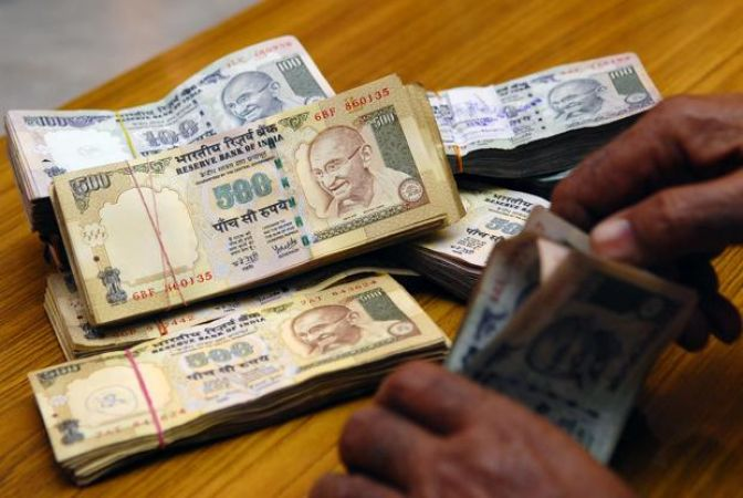 Rupee trades weaker by 13 paise against dollar