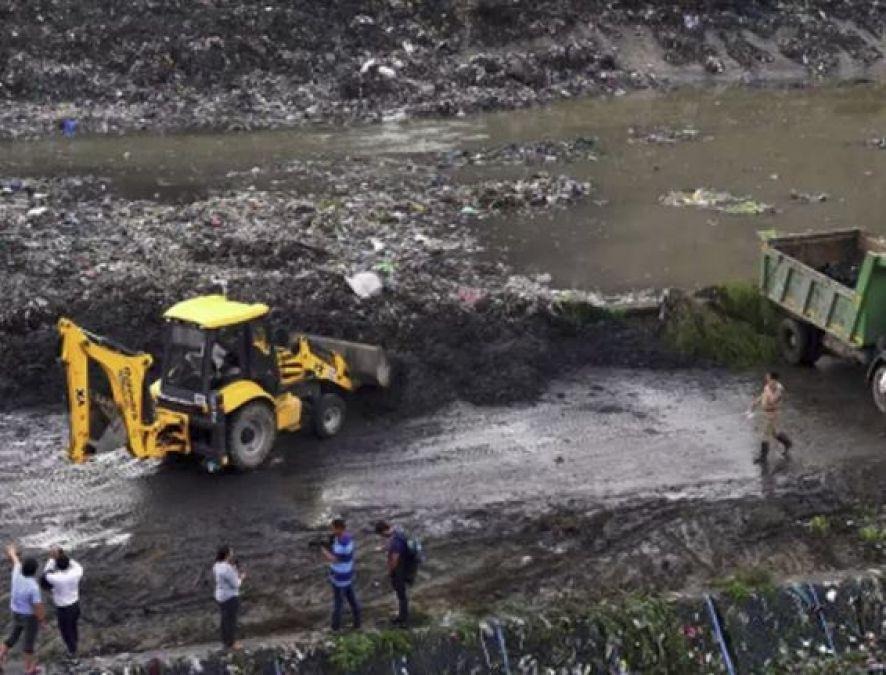 one died and one injured  after garbage mountain falls on house
