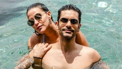 Neha Dhupia along with husband enjoyed in the pool!