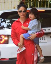 Taimur posed for media by sitting on mother Kareena's lap!