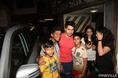 Varun Dhawan clicks photo with his younger fans out of gym