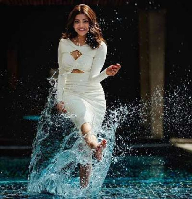 Kajal Agarwal, playing with water, looked extremely hot in a white dress!