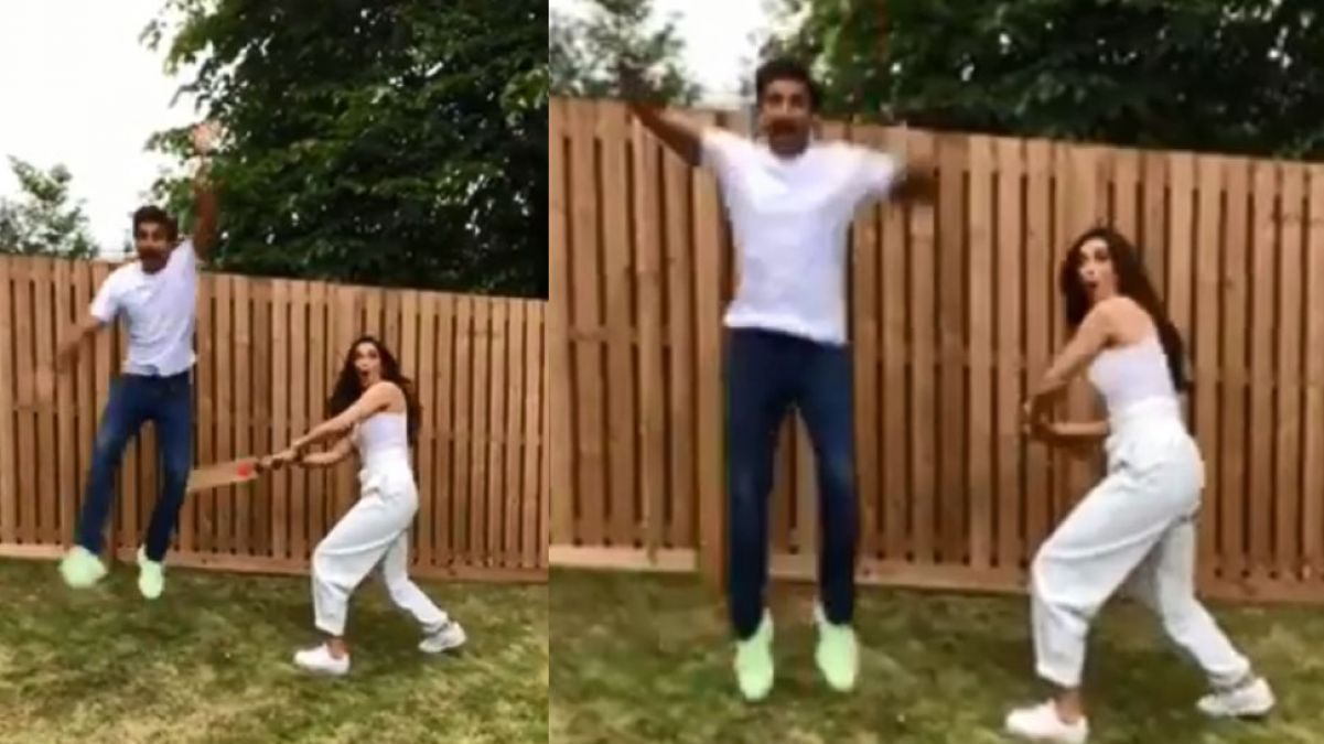 VIDEO: Deepika is seen thrashing Ranveer with a cricket bat in a funny way!