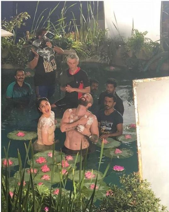 Viral Post: Kareena Kapoor taking a picture in the pool with an unknown young man