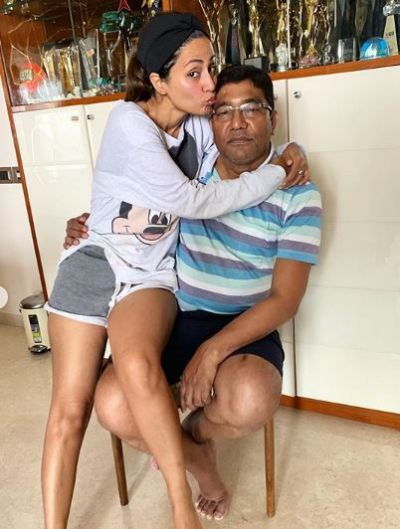 Hina Khan sat on Dad's lap while wearing shorts, trollers said,