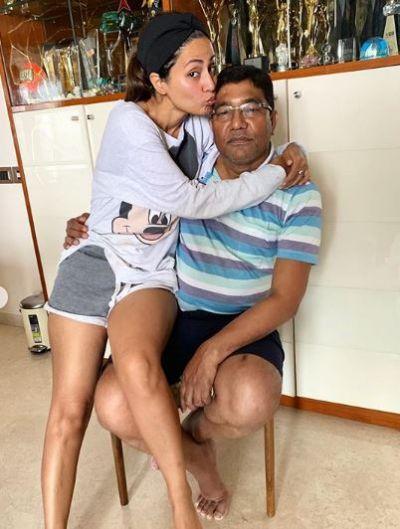 Hina Khan sat on Dad's lap while wearing shorts, trollers said,