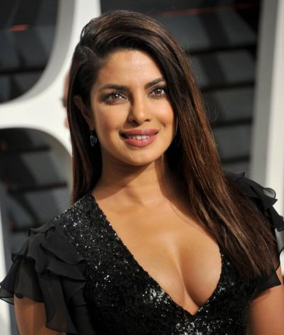 See pic : Priyanka Chopra appears in deep neck sexy gown at Vogue Magazine cover page
