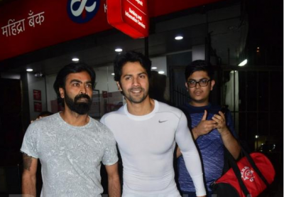 Photo! Six-packs Varun Dhawan gives a smiling pose for camera as he exits the gym