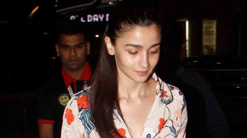 On first day of New year Alia Bhatt trolled for wearing a silk night-suit dress at airport