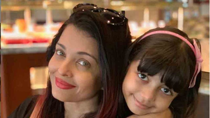 Abhishek Bachchan posts a 'cuddled up' photo of wify Aishwarya Rai Bachchan with daughter Aaradhya