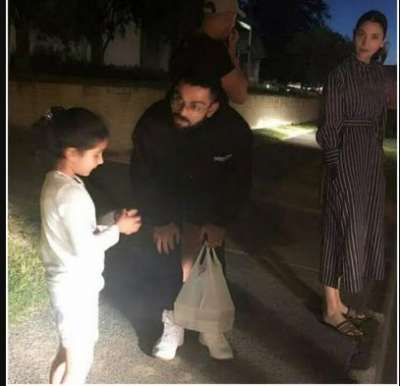 Virat Kohli and Anushka Sharma spotted  interacting with a cute little fan in New Zealand