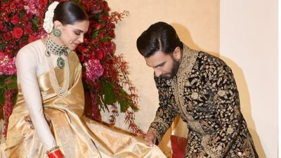 Watch Ranveer Singh helps Deepika Padukone with manging her saree, after blows a  cute kiss