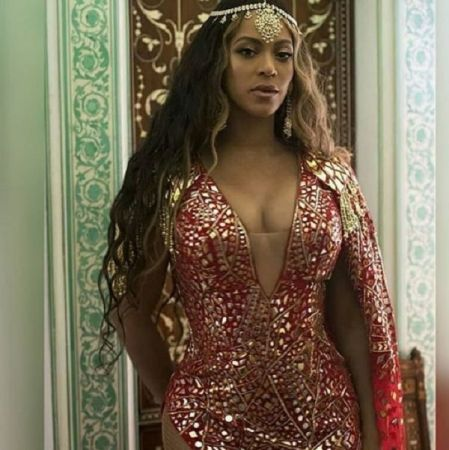 See pics : Beyonce rocks a red and gold mirrored gown with jhumkas and maatha patti  at Isha Ambani's Sangeet night