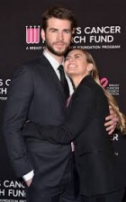 Watch -Miley Cyrus confirms wedding  by kissing Liam Hemsworth and dancing to Uptown Funk in wedding gown
