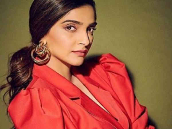2a1d9555ea80 Sonam Kapoor looks stunning in this vintage red pantsuit