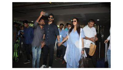 Pics: Neha Dhupia flaunts her baby bump as Angad Bedi walks hand-in-hand with her at Airport
