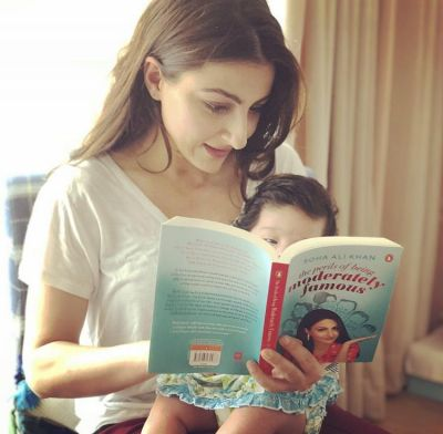 School life began early for Inaaya, mother Soha Ali reading book with her.