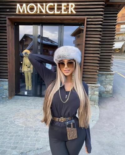 Playboy model Chloe Khan swaps her usual Bikini and hot beach for the icy ski slopes of Switzerland.