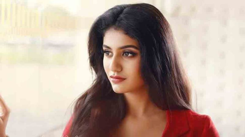 Wink girl Priya Prakash Varrier shares  red outfit pics from her latest photoshoot