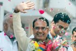 Shivraj's security man carries his shoes in hand