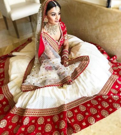 If you're thinking of something different at the wedding, try this red and white lehenga