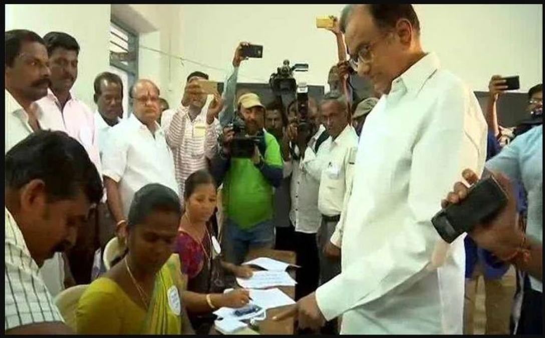 Former FM P Chidambaram cast vote with his family among first voters
