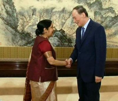 Swaraj accords hands with Chinese Vice President Wang Qishan