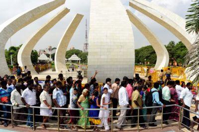 Why do DMK supporters want to bury Karunanidhi on Marina Beach?