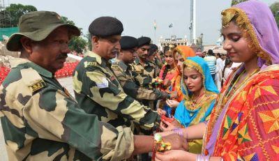 Women tie Rakhi to Indian soldiers at LOC