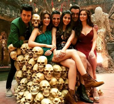 Housefull 4 star cast pose on a throne full of skulls, check out picture here