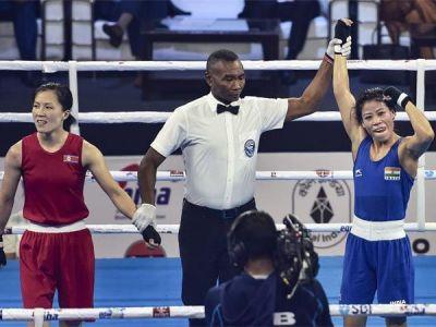 Mary Kom defeats Hanna Okhota wins record sixth gold medal