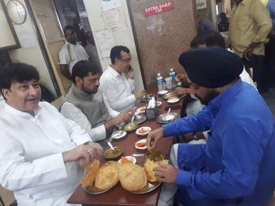 Congress Leader AS Lovely enjoys lovely food before initiating hunger strike