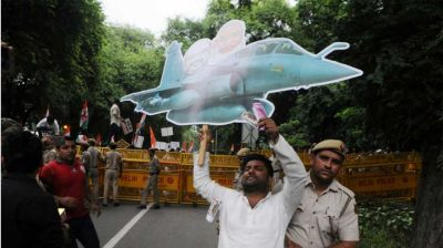 Congress leaders fly paper Rafale plane outside parliament, While CAG report on Rafale presenting inside parliament