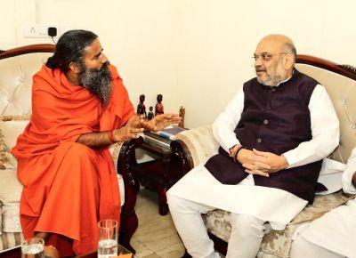 Sampark for Samarthan: Amit Shah meets Ramdev Baba
