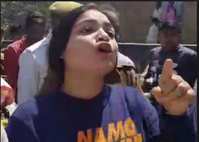 A college girl heckled on wearing 'NaMO Again' T-Shirt by Congress workers