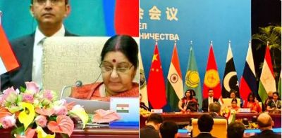 China's foreign minister Wang Yi  welcomes  EAM Swaraj in  SCO meet 2018