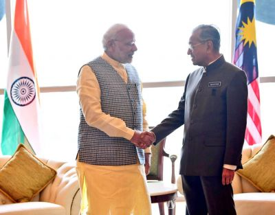 Three-nation visit: PM Modi calls  Dr. Mahathir Mohamad