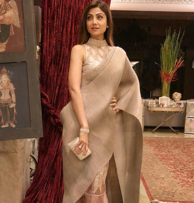 Don't you think Shilpa Shetty's metallic sari is perfect for a winter wedding?