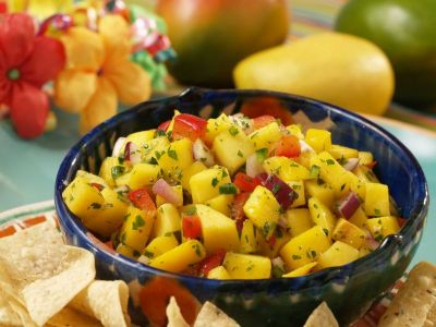 Serve mango salsa with chips and wafers