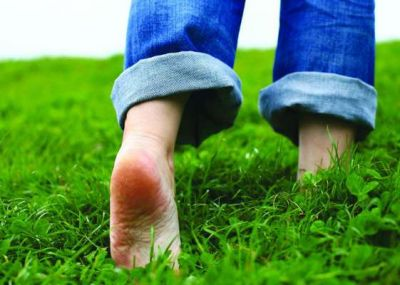 Amazing benefits of walking bare foot on green