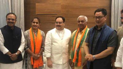 Wrestler Babita Phogat, father Mahavir join BJP, Kiren Rijiju welcomes wrestler duo