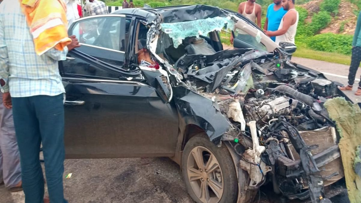 Speeding car collides in standing truck, two killed