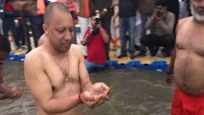 Yogi Adityanath takes holy dip at Sangam on Basant Panchami