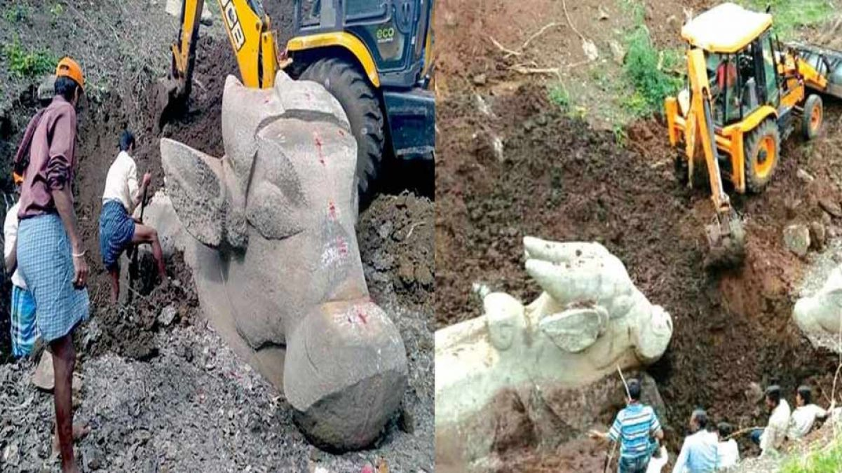 Mysore: Statue of ancient Lord Shivas vehicle Nandi found in an excavation of dry lake, the crowd