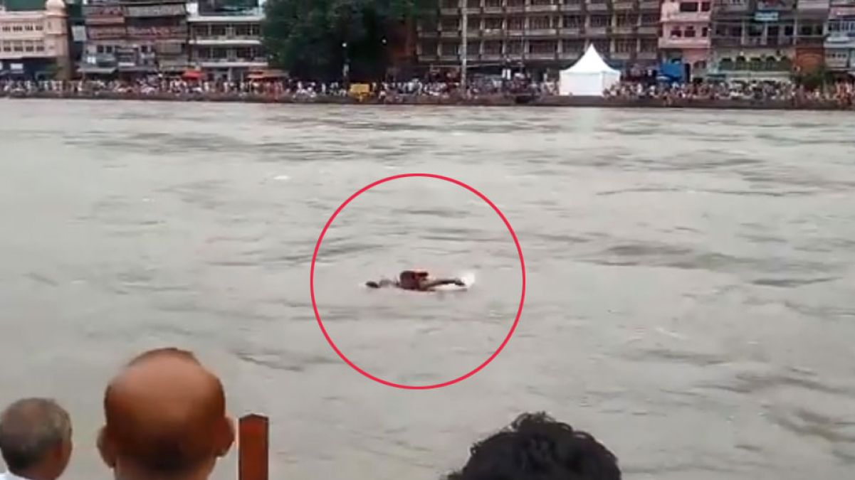 VIDEO: Young man swept across Ganges, rescued by policeman